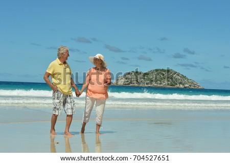couple walking on  beach #704527651