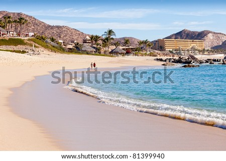 Couple walking on beach in Cabo San Lucas, Mexico