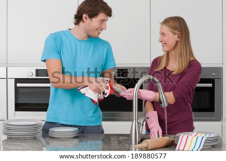 Couple washing up the dishes after the party