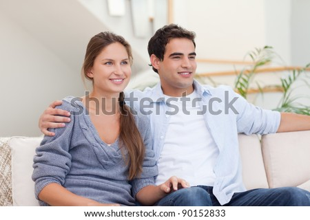 Couple watching a movie in their living room
