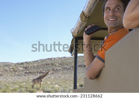 Couple Watching Giraffes on Safari