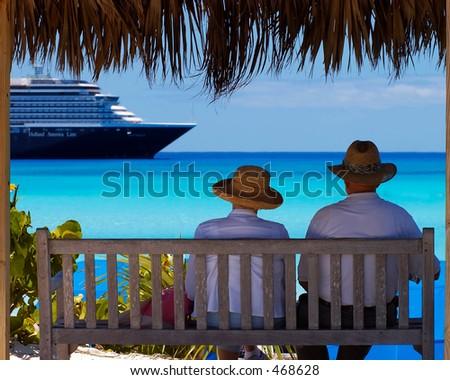 Couple watching ship - stock photo