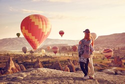 Couple watching the hot air balloons at the hill of Goreme, Cappadocia, Turkey.Cappadocia one of the best places to fly with hot air balloons.