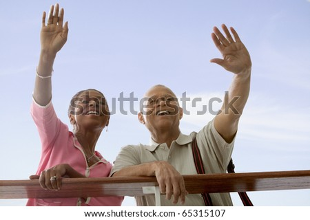 Couple waving goodbye