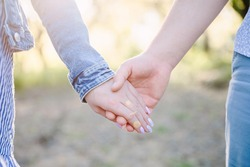 Couple Wife Husband Dating Relaxation Love Concept. Couple hands together touch with love. People, family, care and support concept - close up of young  woman and man holding hands together