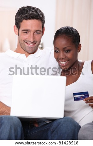 Couple with a laptop and a credit card