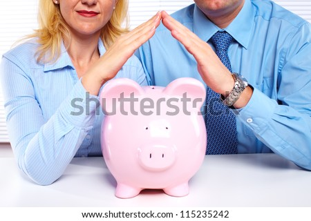 Couple with a piggy bank. Saving money.