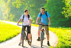 couple with bicycles in the park