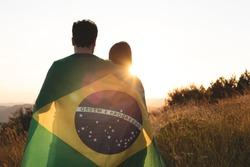 couple with brazilian flag