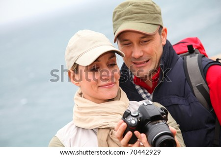 Couple with camera on hiking day