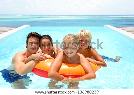 Couple with children enjoying bath time