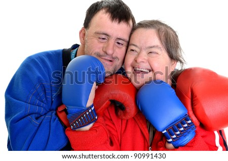 http://image.shutterstock.com/display_pic_with_logo/94683/94683,1324152615,2/stock-photo-couple-with-down-syndrome-in-boxing-gloves-on-white-90991430.jpg