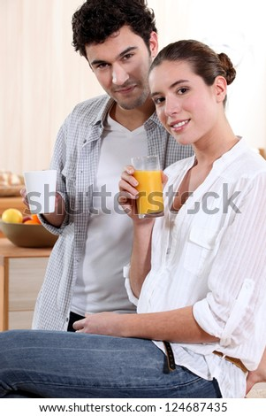 Couple with drinks at home