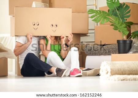 Couple with empty boxes on heads with smiley on it