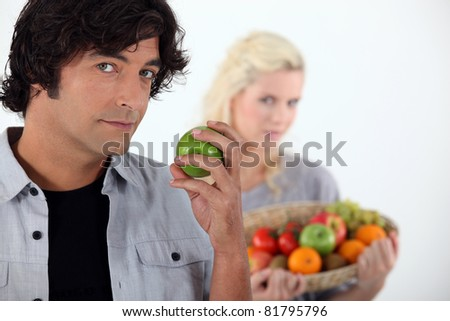 Couple with fruit basket - stock photo