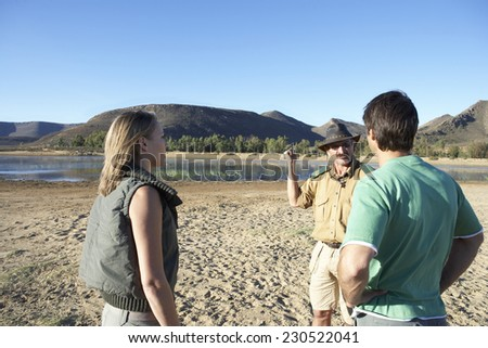 Couple with Guide on Safari