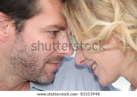 Couple with heads together