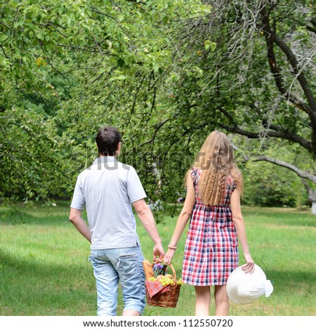 Couple with picnic basket outdoors