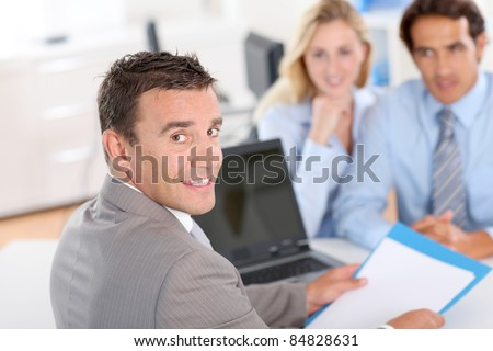 Couple with real-estate agent in office