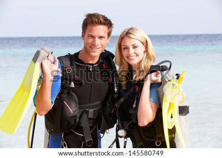 Couple With Scuba Diving Equipment Enjoying Beach Holiday #145580749