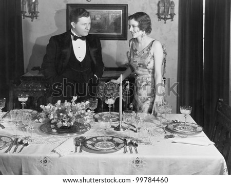 Couple with table set for dinner