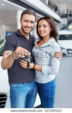 Couple with the keys to car