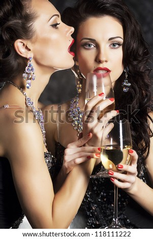Couple Women Celebrating Happy New Year with Wineglasses of Champagne - 2013