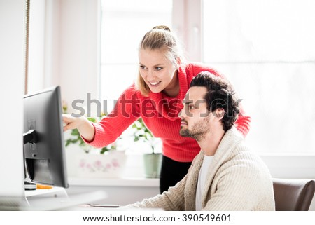 Couple working in home office with phone and computer #390549601