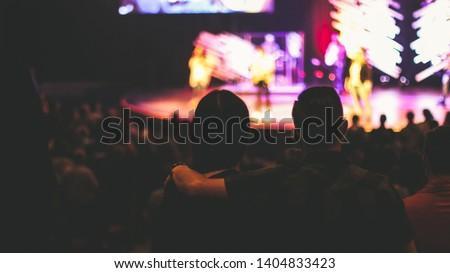 Couple worshiping at church service