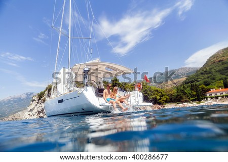 couple yacht honeymoon sailing luxury cruise. View from the water