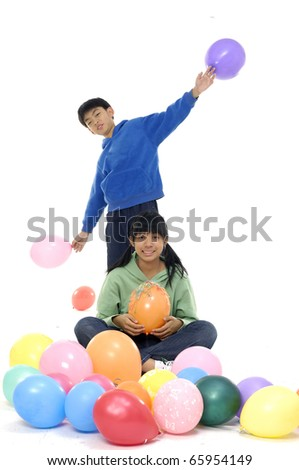 Couple young children in studio with balloons