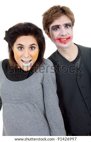 couple young people dressed as clowns, isolated