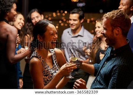 Couples Dancing And Drinking At Evening Party #365582339