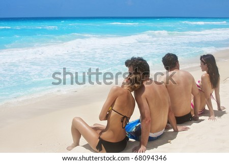 Couples enjoying a Beach vacation