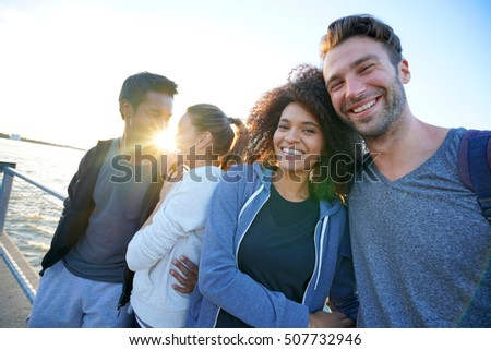 Couples enjoying sunset on Brooklyn heights promenade, NYC