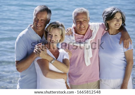 Photo of Couples hugging in front of lake in Germany