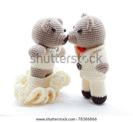 couples of bride and groom bears kiss and getting married isolated on white