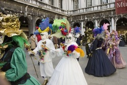 couples prepare to have a parade for carnivale in venice,Italy.Mardi Gras of europe