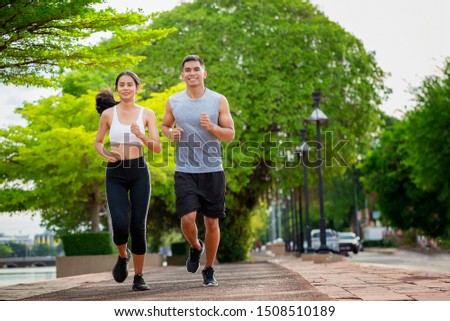Couples who take care of their health by exercising happily in the city. Health care concept Stock photo ©