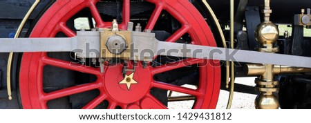 coupling rod or side rod connects the driving wheels of a locomotive #1429431812