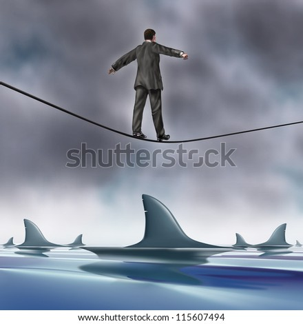Courage and risk business concept with a business man in a grey suit walking on a tightrope with dangerous sharks circling underneath as a risk and symbol of determination and strength.