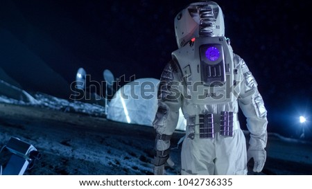 Courageous Astronaut in the Space Suit Walks on the Surface of the Alien Planet. Exploring Newly Discovered Planet. Interstellar Space Travel and Extraterrestrial Colonization Concept.