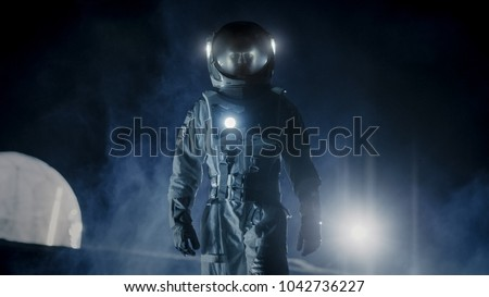 Courageous Astronaut in the Space Suit with Flashlight Explores Mysterious Alien Planet Covered in Mist. Adventure. Space Travel, Habitable World and Colonization Concept. #1042736227