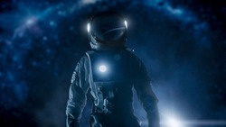 Courageous Astronaut in the Space Suit with Flashlight Explores Mysterious Alien Planet. The Milky Way Galaxy in Background. Adventure. Space Travel, Habitable World and Colonization Concept.
