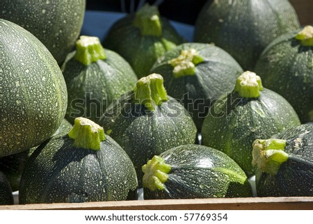Courgettes in a box on the farmers market.