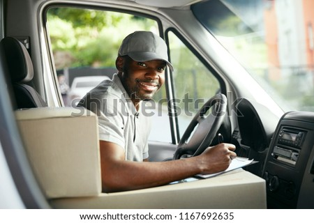 Courier Delivery. Black Man Driver Driving Delivery Car  #1167692635