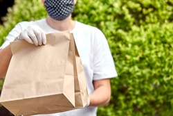 Courierin white hold go box food, delivery service, Takeaway restaurants food delivery to home door. Stay at home safe lives from coronavirus outbreak. Contactless delivery service under quarantine.