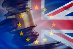 Court gavel strike with European Union and The United Kingdom flags combined in Brexit concept background
