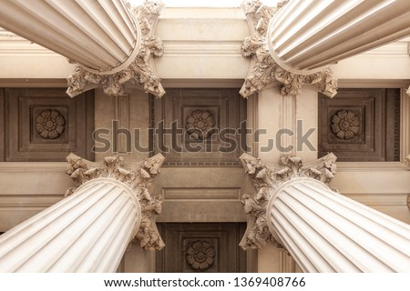 Court house or museum pillars or columns looking straight up and symmetrical