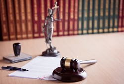 Court Judge's gavel, Themis - the goddess of justice and law codes in the background. Law office. Law concept.